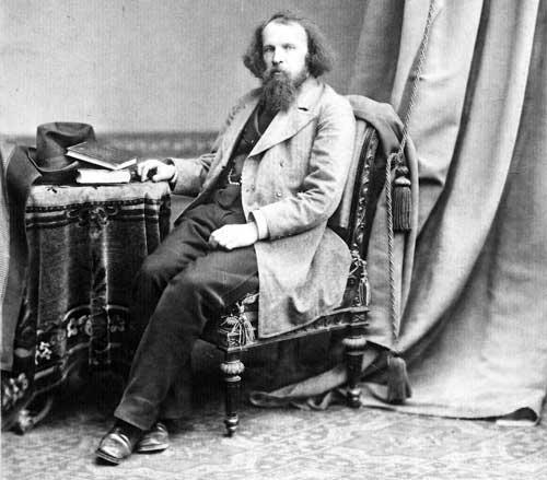 Dmitri-Mendeleev-working-on-table